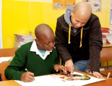 Teacher assisting a learner