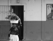 Woman carrying food parcel on her head 2