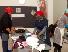 Women sorting clothes 3