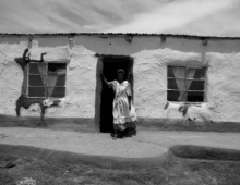 Woman infront of a house 2
