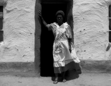 Woman infront of a house 1