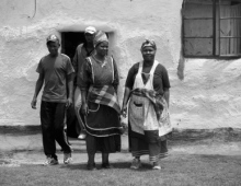 People infront of a rural house